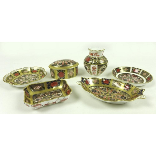543 - A collection of Royal Crown Derby bone china items, comprising a lidded oval box, Old Imari pattern,...