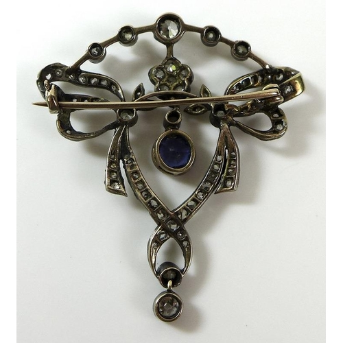 819 - An Edwardian cornflower sapphire and diamond brooch, the stones mounted in silver and gold in the fo...