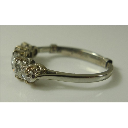 820 - A diamond and platinum five stone ring, the graduated stones approximately 1ct total weight, size J ...