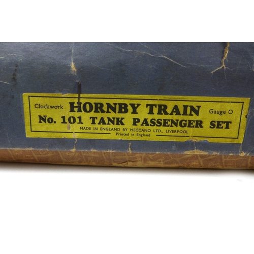 617 - A group of Hornby O gauge comprising a clockwork locomotive, number 3829 and tender, a 3830 locomoti...