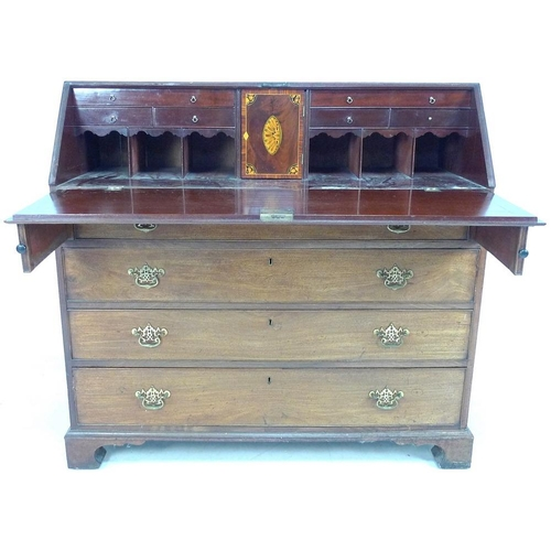 929 - A George III mahogany and crossbanded bureau, fall front with fitted interior, four graduating drawe...