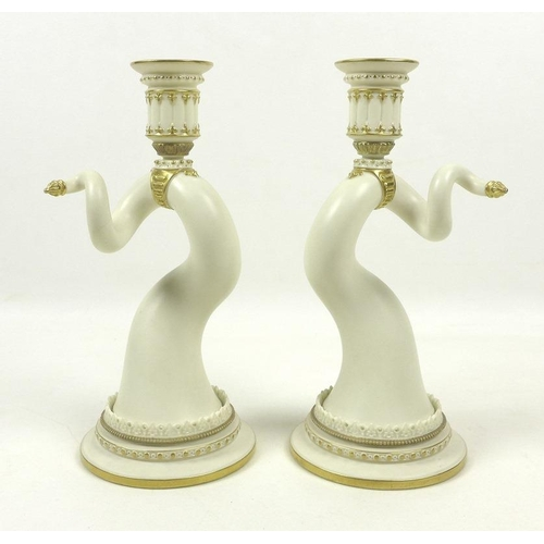 502 - A pair of Royal Worcester porcelain candlesticks, circa 1890, shape 1056, modelled as a mirrored pai...