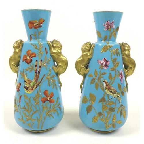 505 - A pair of Royal Crown Derby vases, late 19th century, of tapering form with applied gold panther han...