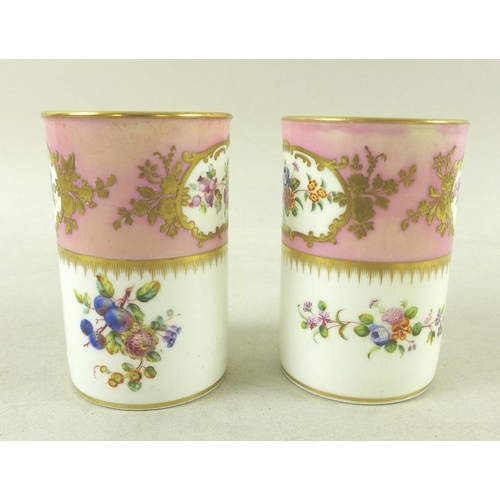 512 - A group of English and Continental porcelain, 19th century and later, comprising a pair of cylindric...