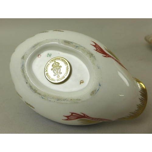 517 - A Royal Crown Derby bone china paperweight, modelled as a duck, gold stopper, 12cm long, a set of si...