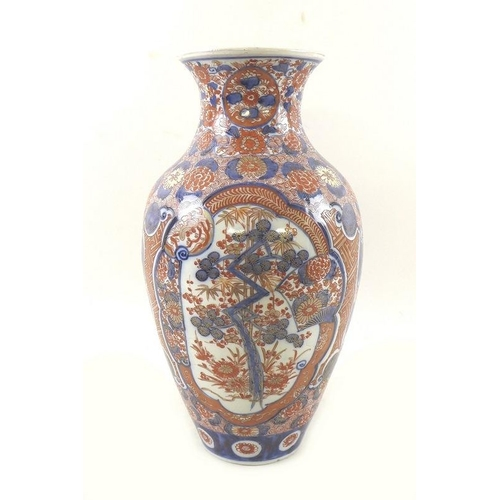 518 - A 19th century Japanese imari vase,shaped foliate reserves containing prunus trees, bamboo and phoen...