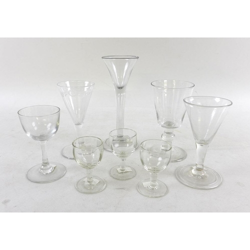 520 - A collection of Georgian and later glasses including ale, wine and cordial glasses, several with fol...