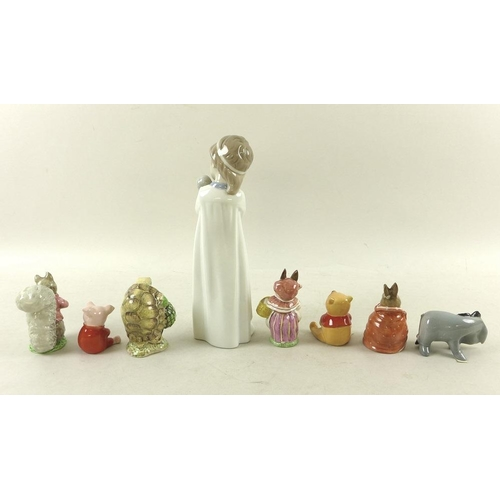 521 - A collection of ceramic figurines, including Nao model of Girl with Doll, 25cm, Beswick Beatrix Pott...
