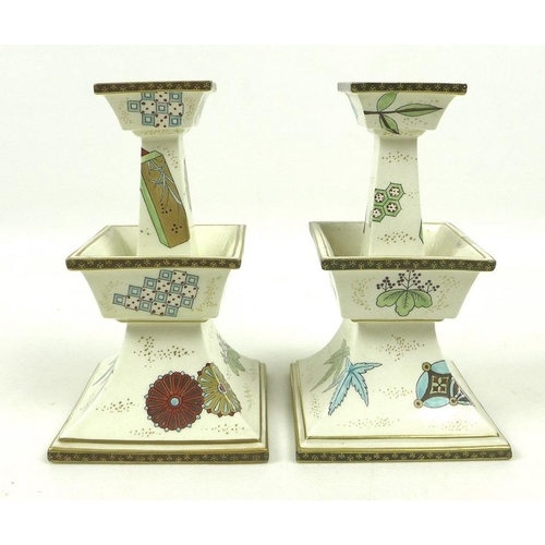 532 - A pair of Royal Worcester porcelain candlesticks, circa 1874, in the Japanese taste, of stepped tape...