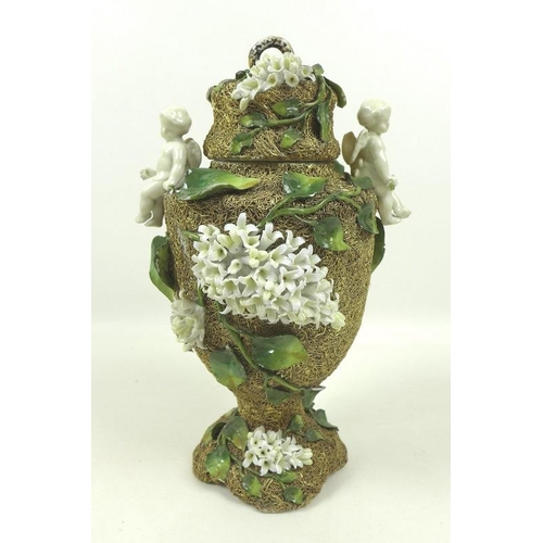 534 - A late 19th century Continental porcelain vase and cover, of baluster form with applied gold mesh de...