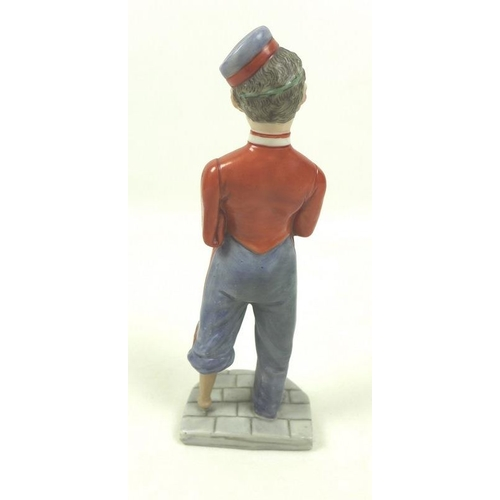 535 - A Royal Worcester porcelain figurine, circa 1900, modelled as After War, with blue / grey and red un...