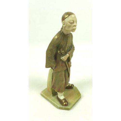 536 - A Royal Worcester porcelain figurine, circa 1892, modelled as a Chinese man with a cap holding a pip...