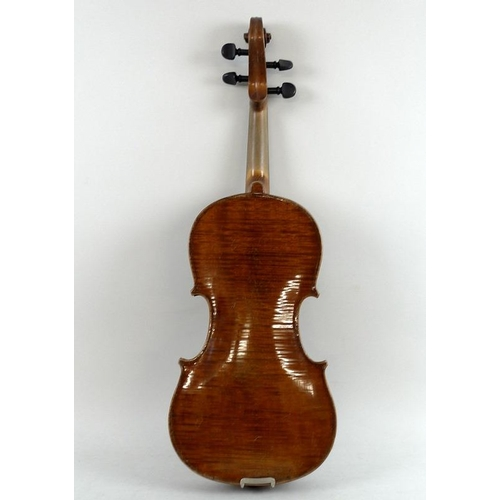 655 - A 4/4 violin, with well flamed one piece back, scroll carved with precision bow, in a faux crocodile...