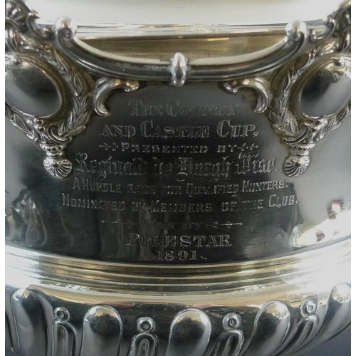 725 - An impressive Victorian silver trophy, of monteith form with chased and embossed band of wrythen gad...