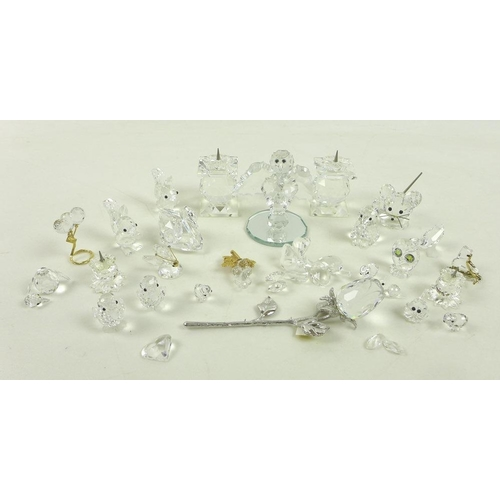 726 - A group of twenty two Swarovski animals and items including a mouse, two pairs of candlesticks, a se...