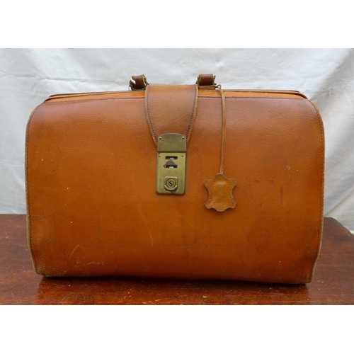 1 - A vintage tan leather Gladstone bag with brass fittings....