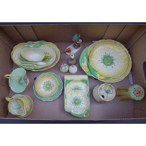 10 - A group of ceramics comprising Carltonware Australia pattern dishes and wares, a Hummel figure of a ...