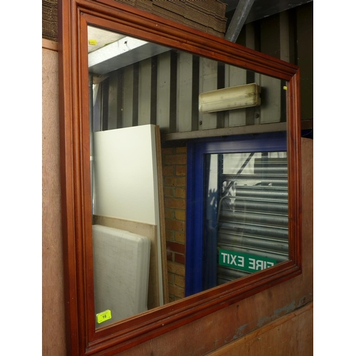 16 - A modern wall mirror with rectangular plate, in a stained pine frame....