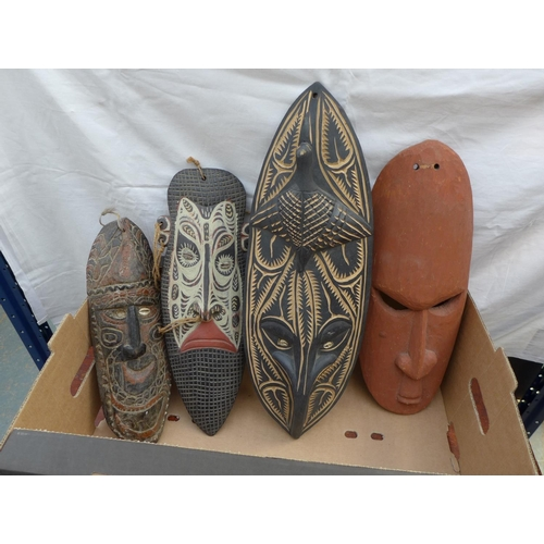 2 - A selection of four African carved wooden masks, one early to mid 20th century, the others later. (1...