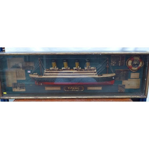 21 - A large commemorative wall plaque with a half hull model of the Titanic encircled by various informa...