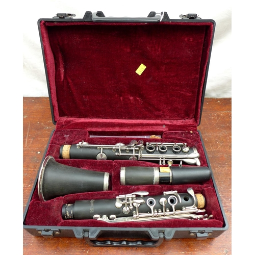 32 - A 20th century student's clarinet by Blessing, in original hard carry case, 30 by 9 by 25cm....