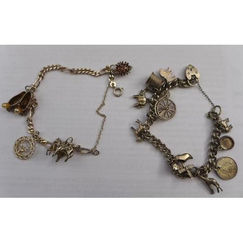 39 - Two silver charm bracelets, 53g. (2)...
