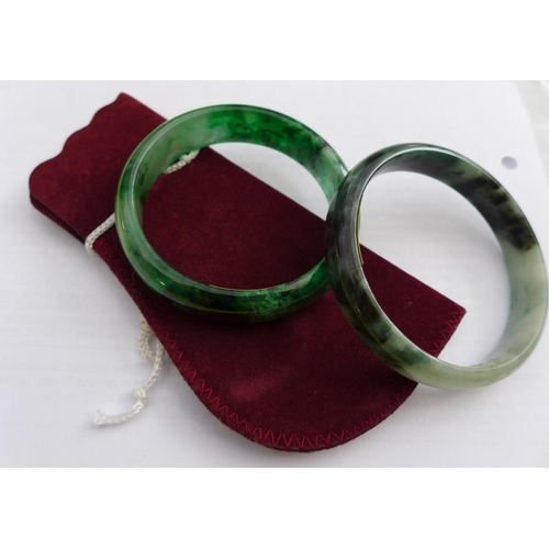 40 - Two modern glass bangles, made to look like apple and spinach jade. (2)...
