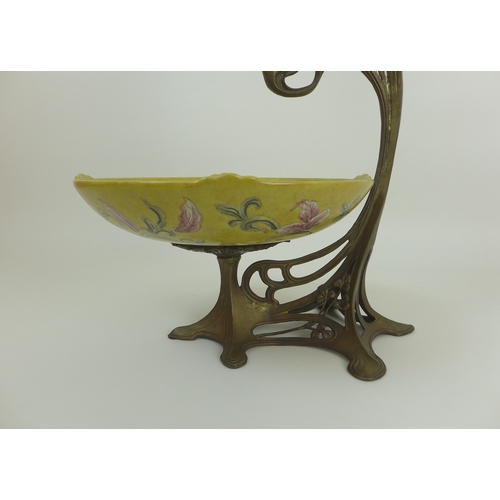 37 - An Art Nouveau centrepiece in the style of WMF, the gilt metal mount in the form of a young girl rea...
