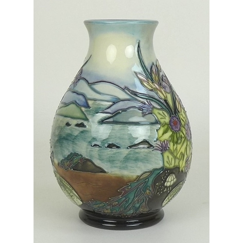 15 - A Moorcroft Islay pattern baluster vase, the body decorated with shells and seaweed, coastline beyon...