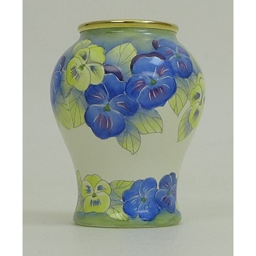 4 - A modern Moorcroft vase and cover, the body depicting cream and pink orchids on cream and black grou...