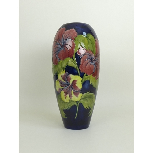 22 - A large mid 20th century Moorcroft hibiscus pattern vase, impressed and painted marks to base along ...