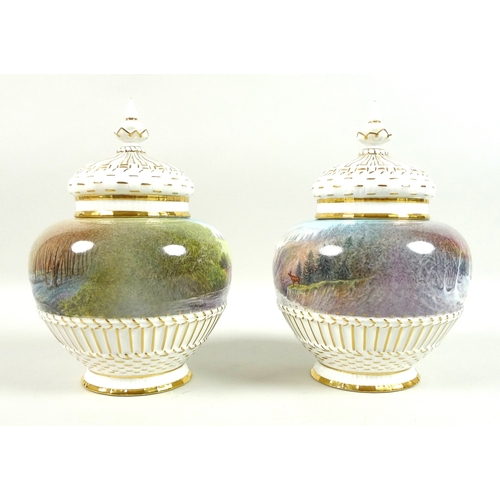 28 - A pair of modern Royal Worcester potpourri vases and pierced covers, decorated by M. Powell in 'Spri...
