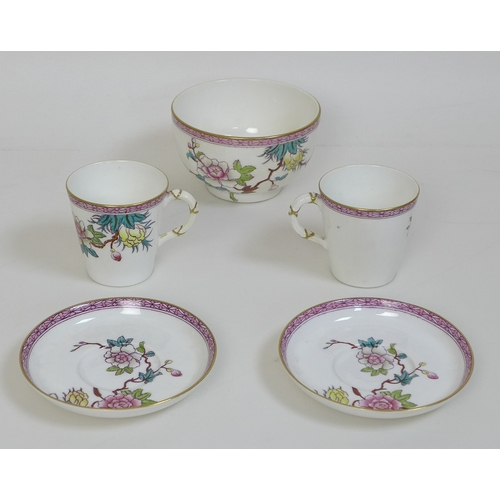 3 - A Victorian Royal Worcester porcelain tete a tete tea service, decorated in Chinese style with prunu...