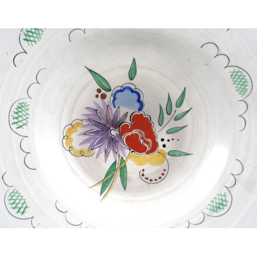 5 - A Clarice Cliff for Wilkinson Ltd charger, decorated with chrysanthemums, spring flowers and clouds ...