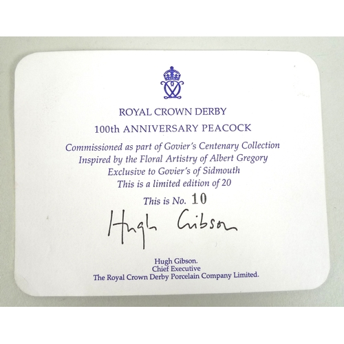 19 - A Royal Crown Derby china figurine '100th Anniversary Peacock', limited edition 10/20, with certific...