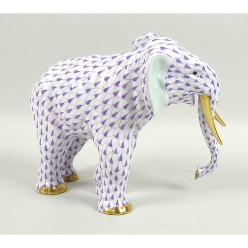23 - A modern Herend model of an elephant, modelled in standing pose, its hide decorated in a purple scal...