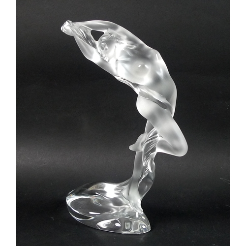 42 - A modern Lalique clear crystal sculpture, modelled as a female nude, 'Arms Up Acrobat', standing on ...