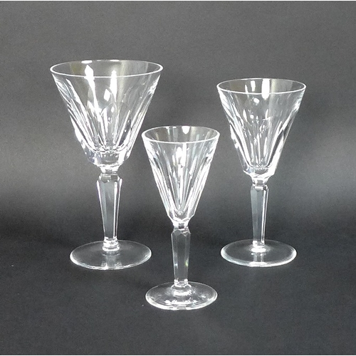 39 - A large collection of Waterford Crystal drinking glasses,  including a suite of table glasses compri...