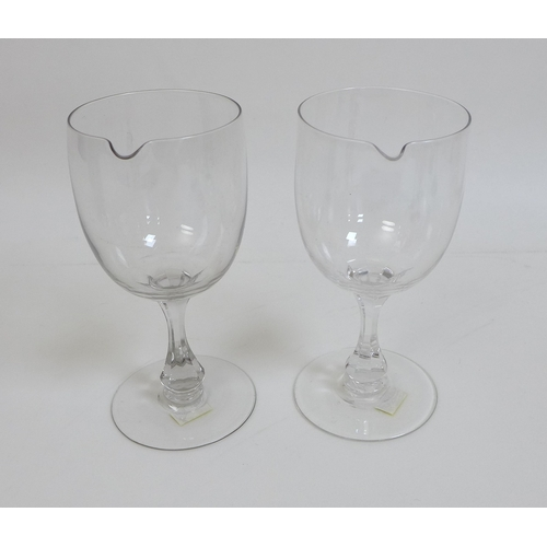 21 - A group of 18th and 19th century glassware, comprising an amber glass trumpet sided wine glass with ...