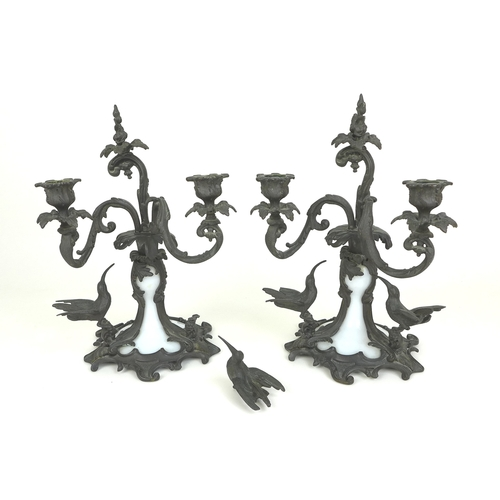 75 - A pair of bronze and milk glass twin branch candlesticks, possibly French 19th century, each with sc...