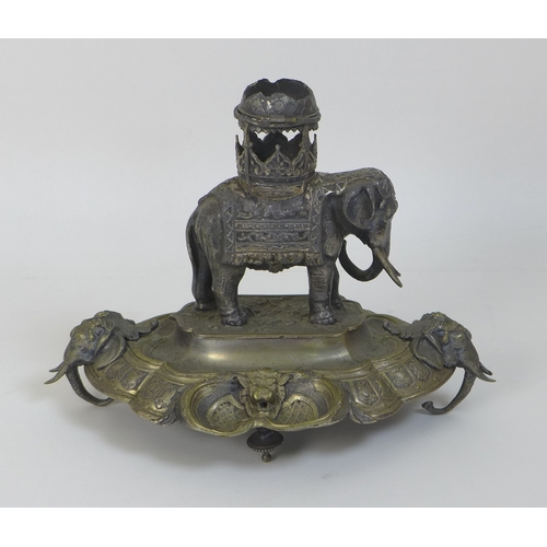 63 - An unusual late 19th or early 20th century brass and white metal inkwell, formed as a silvered eleph...