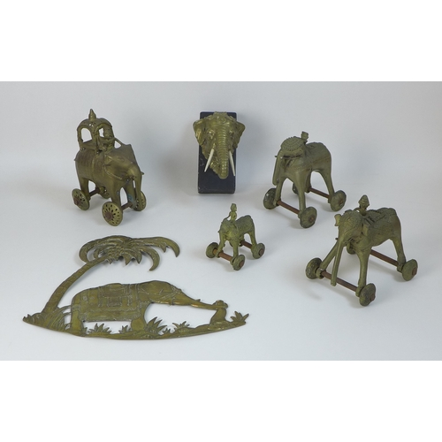 59 - A collection of four Benin style bronze and brass elephants, all with mahouts and one with howdah, c...