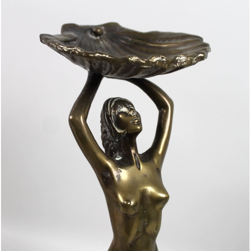 49 - A polished bronze award statuette won by Peter Boizot in 1989, modelled as a female nude holding alo...
