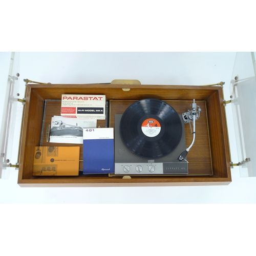 206 - A Garrard 401 record player, circa 1960, with accessories compartment and desk mounted case, 96 by 5...