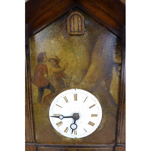 69 - A 19th century cuckoo wall clock, painted case with two figures, with two weights, and pendulum. 32....