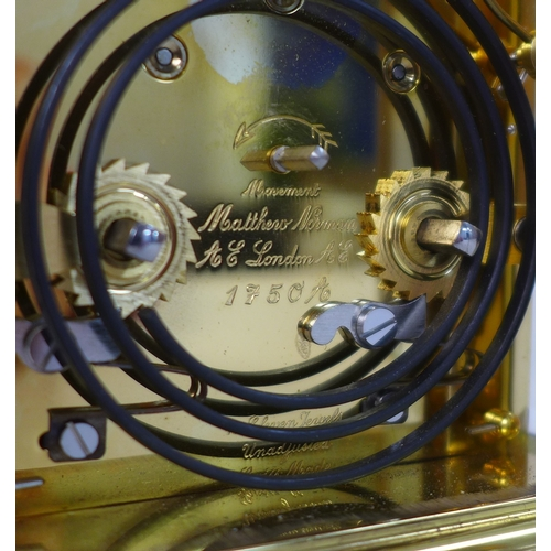 54 - A 20th century carriage clock by Matthew Norman, the white dial with black Roman numerals and minute...
