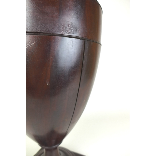 53 - A 19th century mahogany pedestal urn knife box, the lid lifting to reveal fitted interior, 25 by 60c...