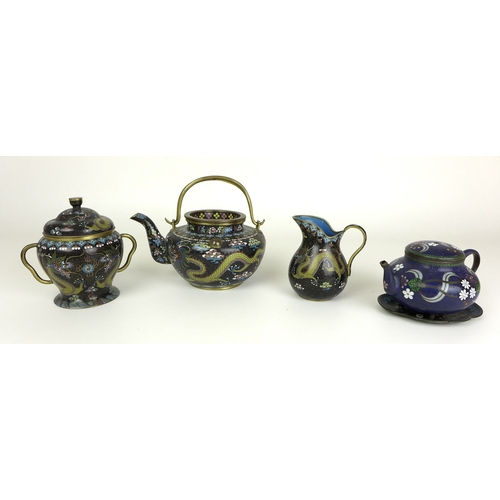 66 - A Chinese Cloisonne bachelor's tea set, comprising teapot, sugar bowl and milk jug, the black ground...