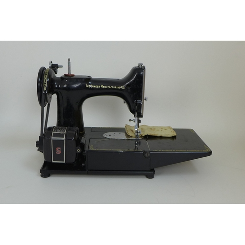 57 - Singer 222K electric sewing machine, complete with original case, keys, foot pedal  and cable, bobbi...