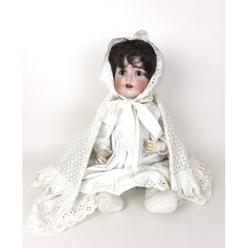 106 - An early 20th century German bisque headed doll, marked Germany to back of neck, clothed in vintage ...